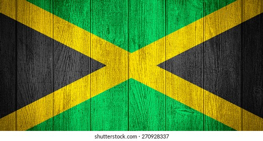 Jamaica flag or Jamaican banner on wooden boards background