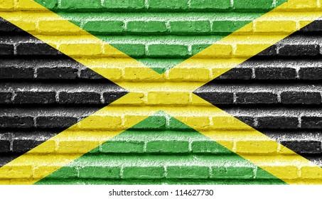 Jamaica flag on an old brick wall