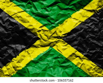 The Jamaica flag painted on crumpled paper