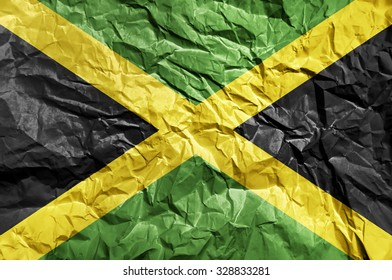 Jamaica flag painted on crumpled paper background
