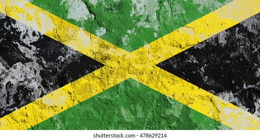 The Jamaica flag painted on grunge wall