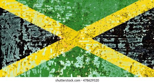 The Jamaica flag painted on grunge metal