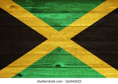 Jamaica Flag painted on old wood plank background