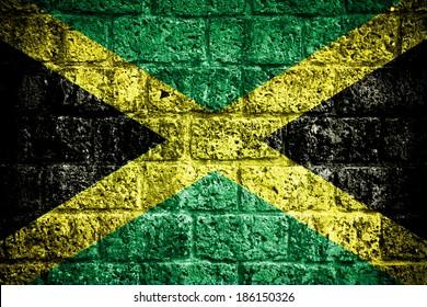 Jamaica flag painted on old brick wall