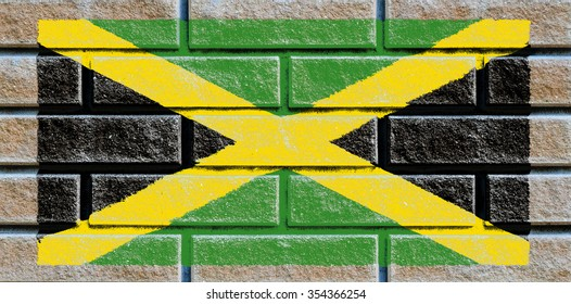 Jamaica flag painted on old brick wall texture background