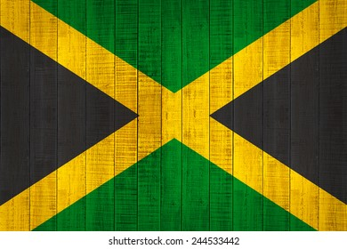 Jamaica flag and wood background