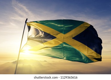 Jamaica national flag textile cloth fabric waving on the top