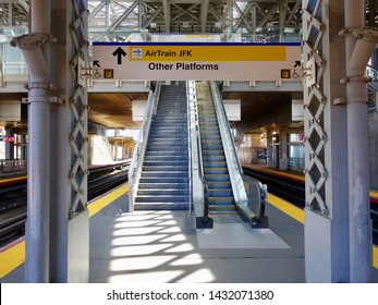 JAMAICA, NEW YORK - MAY 21, 2019: Shadows crisscross on the LIRR railroad platform on May 21, 2019 in Jamaica, NY. The Jamaica station connects the JFK Airport AirTrain with subways and trains to NYC.