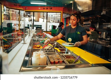 JAMAICA PLAIN, MA, USA - NOVEMBER 18 2018: kitchen in cafe Achilitos taqueria. cook in the kitchen. Mexican food. Boston, MA, USA