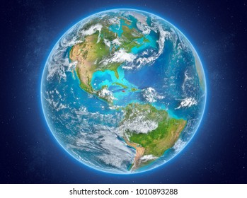 Jamaica in red on model of planet Earth with clouds and atmosphere in space. 3D illustration. Elements of this image furnished by NASA.