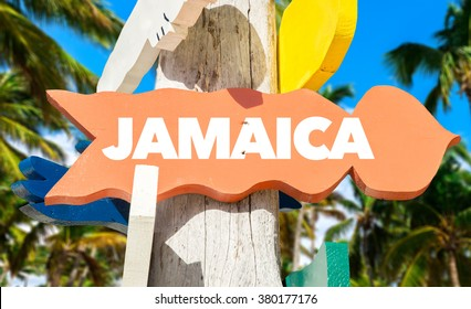 Jamaica welcome sign with palm trees