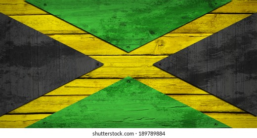Jamaican flag painted on wooden boards. Grunge style