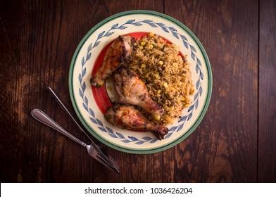 Jamaican jerk chicken legs with corn and bean rice
