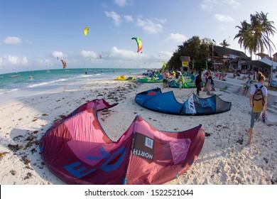 Jambiani, Zanzibar, Tanzania - February 02 2018: Kiteboarding near Jambiani village. Zanzibar is one of the best places for kiteboarding vacations. Warm shallow water and constant wind.