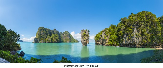 James Bond island (Phang Nga) found off the coast of Phuket in Thailand. Surrounded by clear waters and lush green mountain cliffs, its name originates from a James Bond movie that had been shot there