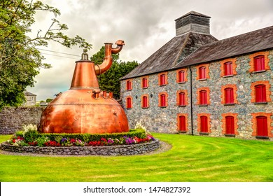 Jamesons Distillery, Cork, Ireland - July 6, 2019: Entrance and bottles on display at the Jamesons Distillery outside of Cork Ireland.