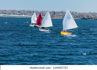 Jamestown, Rhode Island, USA - January 12, 2008: Line of small sailboats in winter race off Jamestown
