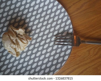 Jammed paper on plate - diet concept