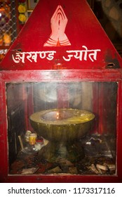 Jammu / India 23 July 2018  Forty years old oil lamp deformed wick in hindu temple at Jammu and Kashmir India