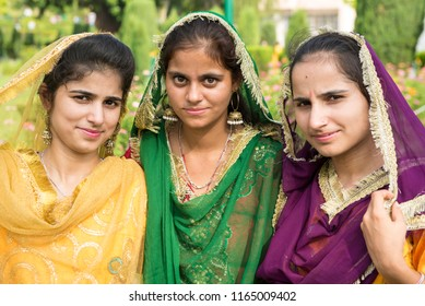 Jammu / India 24 July 2018 Portrait of attractive Indian three dogra girls best friend together having fun in the garden at Jammu and Kashmir India
