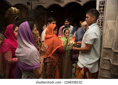 Jammu / India 25 July 2018 People taking blessings from the holy fire after the aarti at Panchbakhtar Temple in Jammu and Kashmir India