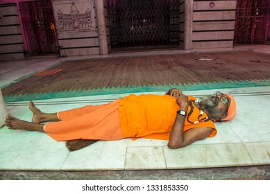 Jammu / India 25 July 2018 holy Man sadhu sleeping on the platform of a temple at Jammu and Kashmir India