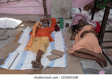 Jammu / India 25 July 2018 Two holy Men sadhu Sleeping on the Street at Jammu and Kashmir India