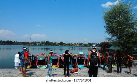 JAMMU KASHMIR, INDIA - JULY 8, 2017:: Colorful shikara boats in Dal lake, Jammu and Kashmir, India. Local people use Shikara for transportation in Dal lake between pier and boat house.