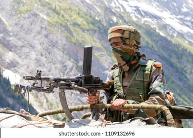 JAMMU AND KASHMIR, INDIA - JUNE 12, 2015 : Unknown Indian frontier guard. Indian Army checkpoint in Kashmir Himalayas. Kashmir became dangerous again