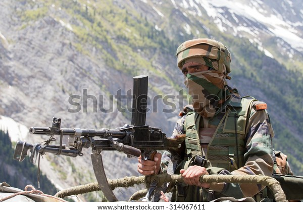 JAMMU AND KASHMIR, INDIA - JUNE 12, 2015 : Unknown Indian frontier guard. Indian Army checkpoint in Kashmir Himalayas. Kashmir became dangerous again.