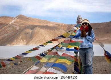 JAMMU KASHMIR, INDIA - MARCH 20 : Traveler thai woman travel visit for take photo with Himalaya mountain and Pangong Tso high grassland lake at Leh Ladakh on March 20, 2019 in Jammu and Kashmir, India