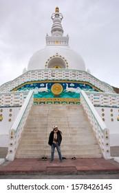 JAMMU KASHMIR, INDIA - MARCH 20 : Travelers thai women people travel visit and respect praying Shanti Stupa on a hilltop in Chanspa at Leh Ladakh Village On March 20, 2019 in Jammu and Kashmir, India