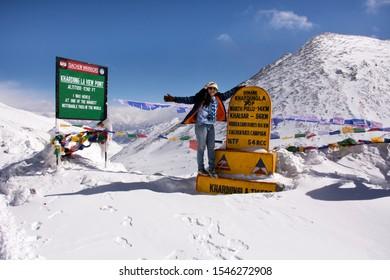 JAMMU KASHMIR, INDIA - MARCH 21 : Travelers thai women visit travel and posing at top of the world of Khardung La Road in Himalaya mountain at Leh Ladakh on March 21, 2019 in Jammu and Kashmir, India