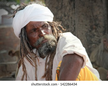 JAMMU/INDIA - JULY 18: Unidentified dressed in white turban sadhu, holy man, stays on July 18, 2012 near ancient fort in Jammu, Jammu & Kashmir state, India, South Asia.