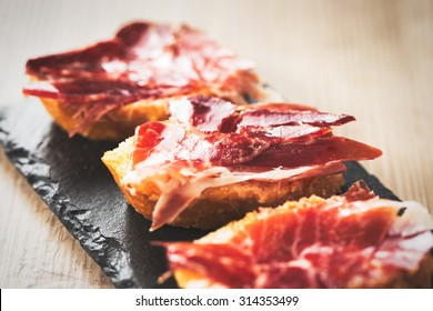 Jamon iberico, the best spanish ham tapas. Vintage food edition.