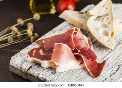Jamon serrano with bread and tomato
