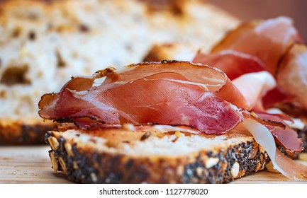 Jamon. Slices of bread with spanish prosciutto hamon.