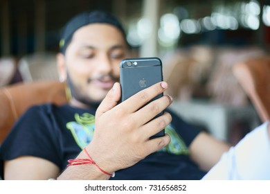 JAMPORE BEACH, DAMAN, INDIA - OCTOBER 9, 2017: A portrait of a young boy attending a video call on his IPhone 7 smart phone, at the JAMPORE BEACH, DAMAN, INDIA.
