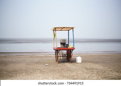 JAMPORE BEACH, DAMAN, INDIA - OCTOBER 10, 2017 - A wide angle shot of a food and snacks cart setup to sell to the tourists visiting the Jampore beach, Daman, India.