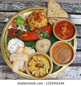Jamshedi Navroz or the Parsi New Year falls 17th 2017 and marks the beginning of New Year as per the Parsi Calendar. A plate full pf traditional parsi veg and non-veg dishes.