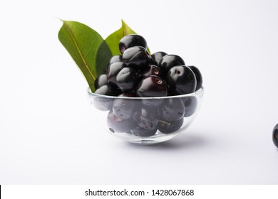jamun fruit in a glass also called as java plum, jambolan plum, jambhul, syzygium cumini