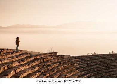 JAN 1, 2018 Pamukkale, Denizli, Turkey : Ruins of ancient Hierapolis Amphi theatre with tourist Pamukkale, Denizili, Turkey