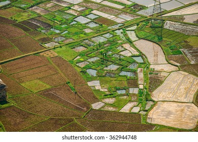 Jan 10, 2016: Valley of Mai Chau, Hoa Binh, Vietnam: As a countryside with the famous fragrant sticky rice. Multiple plots are being filled with water, plowed in preparation for new farming season.