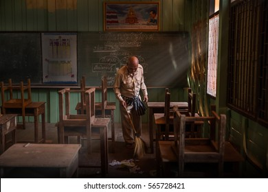 JAN 15,2017 The teacher was sweeping the floor, cleaning the house, the old wooden classroom after school Baan - Wang - Krom School Thailand .