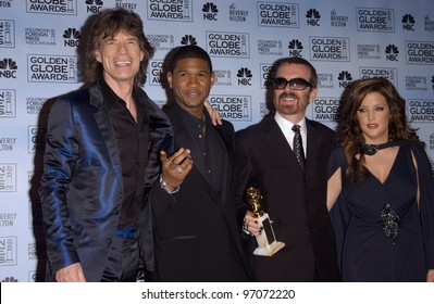 Jan 16, 2005; Los Angeles, CA: MICK JAGGER (left), USHER, DAVE STEWART & LISA MARIE PRESLEY at the 62nd Annual Golden Globe Awards at the beverly Hilton Hotel.