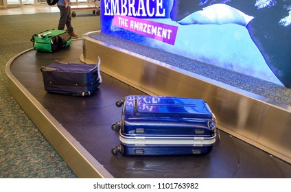 Jan 18 2018 Orlando international airport Florida USA; luggage ride along a baggage carousel waiting for travelers to claim them