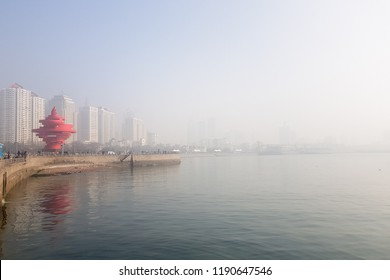 Jan 2018 - Qingdao, China - 4th Maty Square and the seaside walk of Qingdao shrouded by the pollution Haze that often happens in Winter