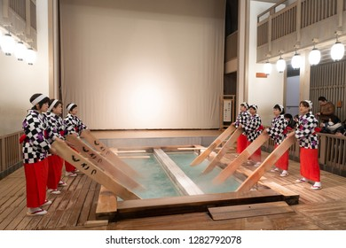 """Jan 2019 - Gunma, JAPAN: Performing of """"Yumomi"""", a traditional way to cool down Kusatsu's hot spring water to bathing temperature without diluting it with cold water."""