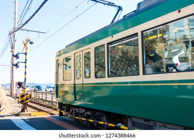"""Jan 2019 - Kamakura,Japan : Enoden Line Train passing by the """"Kamakura koko mae"""" station,  it is a famous spot used for film and drama location. Many tourist came here to take photo of the train."""