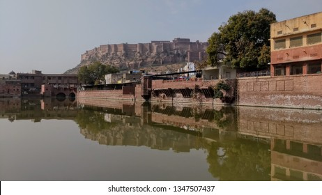 Jan 2019, Mehrangarh fort Jodhpur, Rajasthan, India :  The extreme outdoor full landscape view of the beautiful Mehrangarh fort with its boundary wall with the beautiful gulab sagar lake in the city